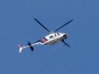 Meanwhile, a Virginia State Police helicopter, tail number N36VA, flew overhead.