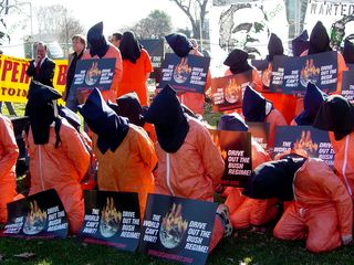 At a World Can't Wait rally on January 4, a number of people dressed in orange jumpsuits and black hoods, intended to symbolize Guantanamo Bay detainees and torture victims.