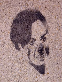 A stenciled graffiti face! How odd it is to see this in Charlottesville, which is relatively graffiti-free.