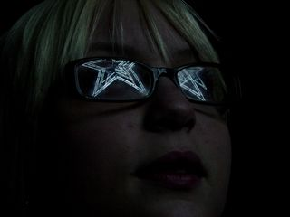 While I was at the star, this woman agreed to let me try something artistic by photographing the reflection of the star off her glasses. It didn't work out the way I wanted, but it was still an interesting concept.