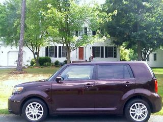 """Then while I was dealing with the bed up in Silver Spring, Mom sent me a photo of her new Scion in front of the house in Stuarts Draft. Note the composition of the photo. This is one of my pet peeves - people putting the subject of the photo way down in the bottom of the frame. Upon seeing this photo, I commented, """"That's a great picture of the house. Next time, move the car out of the way first."""" That comment ultimately led to this photo, which was framed better."""