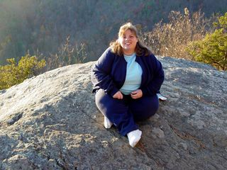 On the day after Thanksgiving, I spent it away from the stores, and out with Katie, where we went up to the Blue Ridge Parkway. Here, Katie poses on a rock at 20-Minute Cliff.