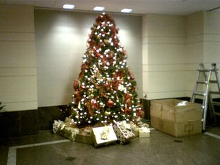 Then in December, the building where I work decorates the lobby for Christmas. It looks very nice when it's done, and it went up on the morning of November 30.