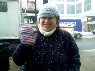 The next day, Mom, Sis, and I went and wandered around the Magnificent Mile. As Sis demonstrates by what has collected on her coat, it was snowing...
