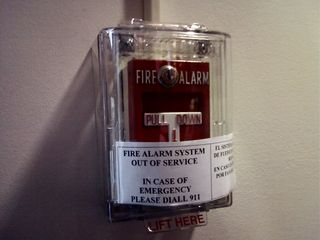 """On March 19, on the way to Funk the War 7, I noticed this sign on a pull station at the JCPenney in Wheaton. It said, """"Fire alarm system out of service"""". That's a little disturbing, don't you think? More disturbing was that this sign actually was posted for months, believe it or not..."""