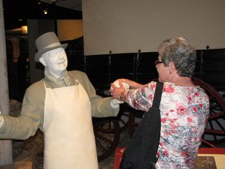 One of Mom's favorite things to do with statues of people that you can get all around is to pretend like she's interacting with them. This works best at wax museums where the figures are colored realistically, but it still worked here, and Mom and I had a blast posing these shots.