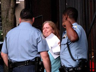 The cops questioned Scientology spokesmodel Sylvia Stanard about the whole affair. I presume that Sylvia is biting her lip in this photo because she's having trouble coming up with a believable lie to tell the police.