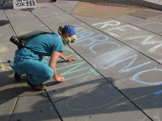Chalking the sidewalk, with the theme about remembering the dead.