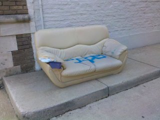 Was March the month to abandon a certain style of couch in Dupont Circle or something? Seriously, the photo on the left was taken on on March 4 on P Street NW in front of Skewers and Cafe Luna. In this case, one arm is missing and the other has its skin torn. Then on March 31, I spotted an identical couch in the alley next to the Avondale apartment building on P Street NW (one block west of the first couch's location). This one, however, had the arm on it, and the cushions were spray painted. You might think that this is the same couch, but the couch in worse condition was photographed nearly a month earlier. Weird, but in any case, it's an ugly couch, so I can't exactly blame people for wanting to get rid of it...