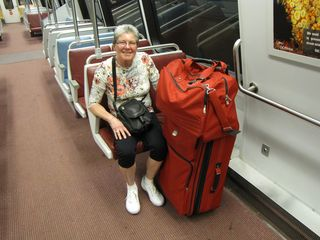 And here we go! Mom poses with her luggage on Alstom 6083 on the Red Line, heading to Union Station.