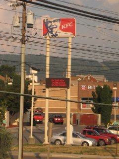 """We made a longer-than-usual stop in Cumberland, Maryland. One thing we noticed was the sign on the KFC. Due to a problem with the LEDs on the sign, it appeared to promote their """"Idwich"""" combo. My camera was able to resolve the missing letters, but it certainly was good for a few laughs."""