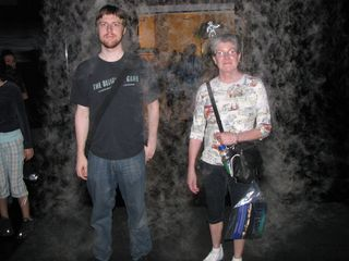 Chris and Mom stand under a curtain of mist...