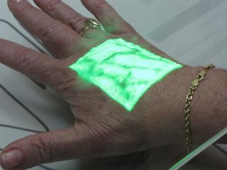 Here, Mom puts her hand under a light that reveals the blood vessels in her hand.