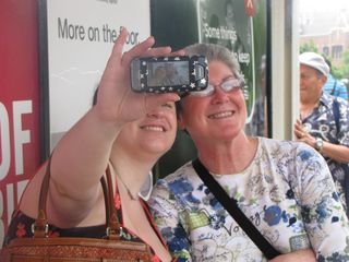Mom and Sis pose for a cell phone photo, while I get a shot of them posing for said photo - with their camera in my shot, as intended.