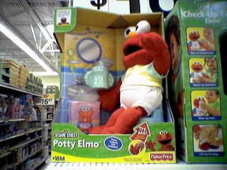 """Katie and I later discovered """"Potty Elmo"""", who sings a song about going to the bathroom to the tune of """"Pop Goes the Weasel"""", and ending with a flush sound."""