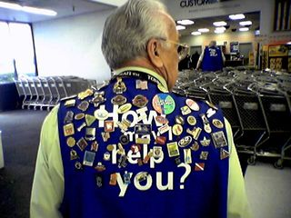 This gentleman is a greeter at the Wal-Mart in Manassas. By the end of the year, he had amassed a collection of more than 400 pins, which he wears on his vest.