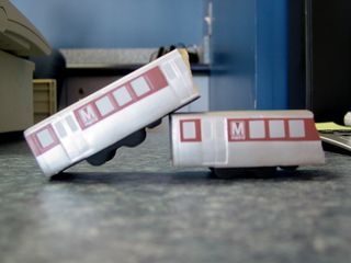 """At the Old Town Transit Shop, where a friend of mine works, which I visited on April 27, they have a foam rubber Metro train that somehow got broken in two. My friend said it was their """"accident train"""". Making a bit of a joke about the November 3, 2004 accident at Woodley Park-Zoo, I put the two pieces in this position. I said that if it were really an accident train, it would look more like this, with a train's having telescoped."""