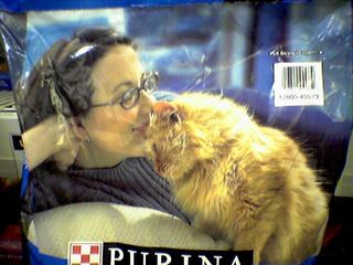 Looking at this photo on the Purina Cat Chow bag, it makes one wonder. It makes me wonder if she's really a cat person, or if she actually hates cats in real life...