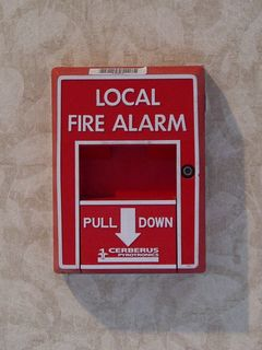 """At the Loews L'Enfant Plaza Hotel, we find a """"local"""" variant of the Cerberus Pyrotronics MS-51 pull station. In Washington, since alarm systems are prohibited by law from transmitting alarms to authorities automatically, many pull stations in Washington carry this wording."""