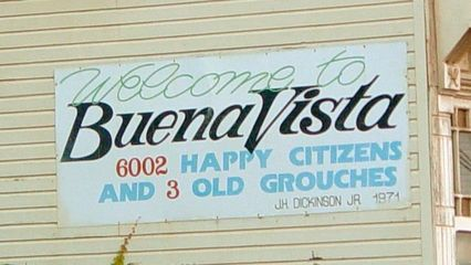 """On September 21, I took a ride on the Blue Ridge Parkway from Waynesboro to near Lexington. At Buena Vista, I encountered this sign that says, """"Welcome to Buena Vista. 6002 happy citizens and 3 old grouches."""""""
