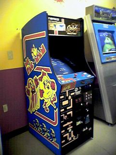 This machine is absolutely awesome. This is the combination Ms. Pac-Man and Galaga machine in the game room at the Lexington Wal-Mart. I've been known to play it quite a bit from time to time. I'd sometimes play Ms. Pac-Man on there, but I'd usually play regular Pac-Man, accessible through an easter egg (up-up-up-down-down-down-left-right-left-right-left on the joystick on the select screen). I could easily play Pac-Man for hours...