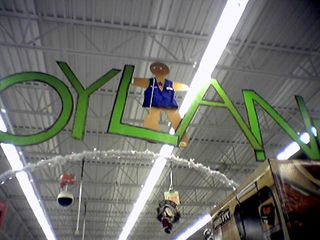 At the Wal-Mart in Warrenton on December 14, Gingy hangs from the ceiling, wearing an authentic Wal-Mart vest and name badge.