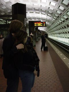 Sis shows Chris the PIDS display on the upper level platform at Rosslyn. We would ultimately ride that six-car Orange Line train to New Carrollton that was to arrive in one minute.