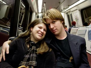 On the Metro, Sis flashes a smile for the camera, while Chris stares directly into the lens.
