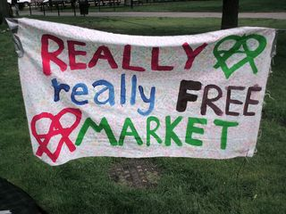 """The """"Really Really Free Market"""" was a monthly event put on by an anarchist collective in Dupont Circle during the summer of 2008. The idea was that of a swap meet, where people brought things that they no longer wanted, and took what they wanted, and no money changed hands. All in all, it was a fun event. The first, shown here, took place on May 10."""
