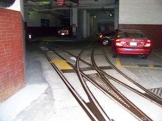 Meanwhile, inside the car barn, which has now been converted for other uses, the old streetcar tracks still exist in the concrete floor!