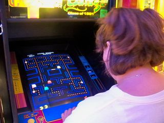 After we finished in the tower, we found a small arcade in the building's ground floor, and Katie got to play her first-ever game of Pac-Man.