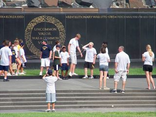 At the Iwo Jima Memorial in Rosslyn, we discovered that the memorial itself was crawling with kids from a school group or something of that sort.
