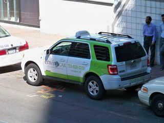 """In Rosslyn in September, I spotted a taxicab operated by EnviroCab. Apparently this cab company promotes itself as being """"green"""" by using hybrid vehicles, but is an SUV, hybrid or not, really all that """"green""""?"""