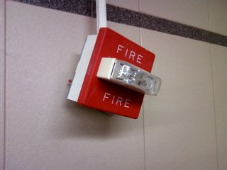 When Mom and I were out and about in Charlottesville, I ran across this - a fire alarm basically dangling from a panduit.