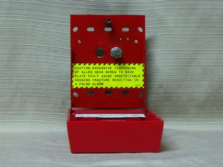 Fire-Lite BG-10, back panel, inside station - note warning about overtightening the screw that holds the station closed