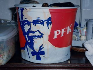 The KFC bucket, as most things are in Canada, was bilingual in French and English. This is the French side, showing KFC in French: PFK.