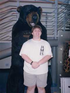 Posing for a photo with a giant bear that was also in the gift shop.