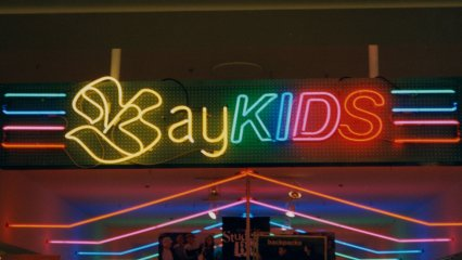 "The children's department had this large sign letting you know that you were there. It was neon, and said ""BAY KIDS"" on it."