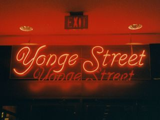 These neon signs were above each of the hotel's main entrances, opening out onto Bay Street, Elm Street, Gerrard Street, and Yonge Street. It was the Yonge Street entrance where Pete took Sarah down the stairs.
