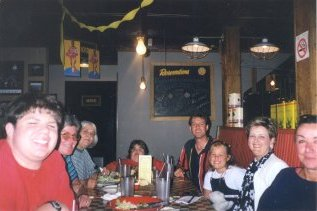 All of us at the table at East Side Mario's, courtesy of Norman. From left to right, there's me, Mom, Darlene, Sarah, Pete, Melissa, Carmen, and Anni.