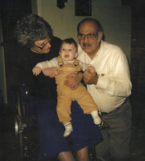 "My grandparents on my father's side, Ruth and Seymour (""Pop"") Schumin, with me as a baby."