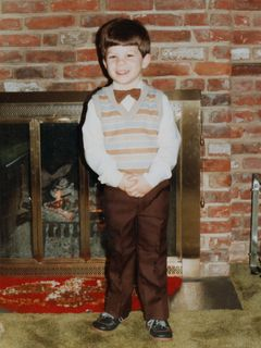 This photo is what resulted from the poor experience at Olan Mills. My parents dressed me up, and took photos of me in the house. Result: adorable!