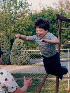 Jumping off our old swingset in Rogers, into Mom's waiting arms.