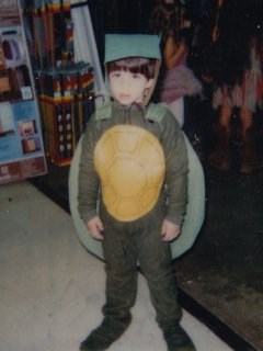 At Kmart in Rogers in 1986, at their children's halloween event. I won first prize for this turtle costume that Mom made for me.