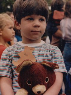 At the Teddy Bear Parade in Rogers, Arkansas in 1985 or 1986, I brought my bear, Chris. Unfortunately, however, Chris the bear later managed to escape my sight and got sold at a yard sale.