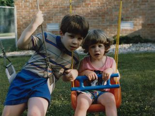 Sis and I pose for the camera on the old swingset in Rogers.