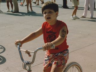 "In the ""Trianimal Triathlon"" in summer 1987. The Trianimal Triathlon was a team-based event, with running, swimming, and bicycling. I was the bicycling part of the team, seen here ahead of my part of the event."