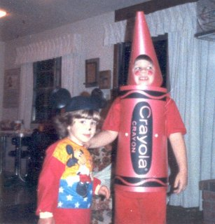 I went as a crayon for Halloween in 1987, and Sis went as Mickey Mouse. And by the looks of it, I've found something far more interesting to look at than the camera.