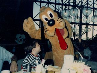 On our 1989 vacation to Florida, while attending the character breakfast at the Contemporary Resort, I spent a moment with Pluto.