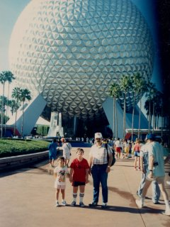 From left to right, Sis, me, and Dad, standing in front of Spaceship Earth at EPCOT Center.